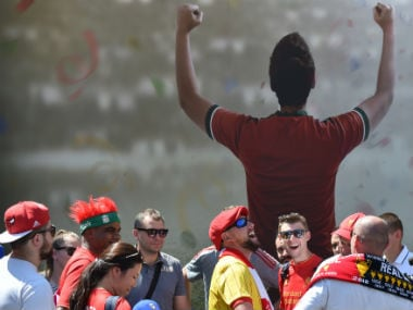 Liverpool fans react at the fan zone in Kiev. AFP