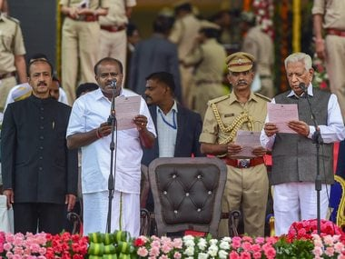 Bengaluru: Karnataka Governor Vajubhai Vala administers the oath to JD(S) leader H D Kumaraswamy as Karnataka Chief Minister during the swearing-in ceremony of JD(S)-Congress coalition government, in Bengaluru, on Wednesday. PTI