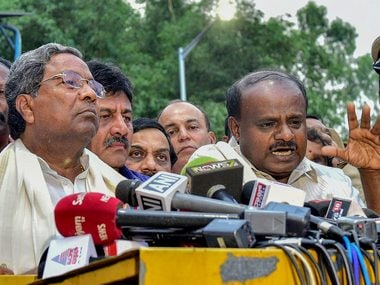 Outgoing Karnataka Chief Minister Siddaramaiah and JD(S) President HD Kumaraswamy address the media after a meeting with Governor. PTI