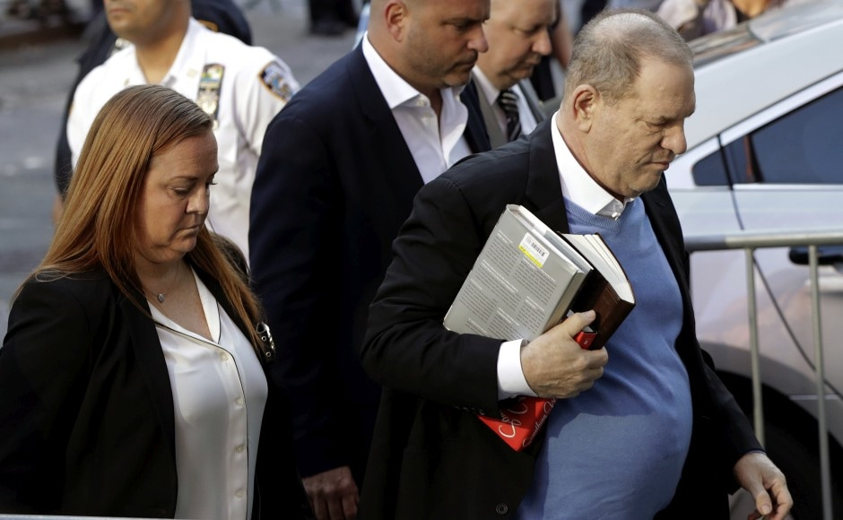 Weinstein lumbered into a police station carrying books that harkened to his show-business roots: one on the Broadway songwriting team of Rodgers and Hammerstein, and another about famed film director Elia Kazan. AP