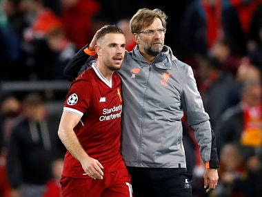 Liverpool manager Juergen Klopp celebrates with Jordan Henderson after the match. Reuters