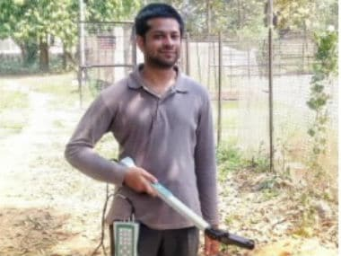 Arideep Mukherjee working in the field with canopy analyser.