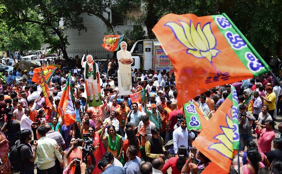 BJP workers celebrating outside the party office in Bengaluru. BJP activists and leaders celebrated in both Bengaluru and New Delhi, waving party flags and shouting slogans hailing Prime Minister Narendra Modi, their main vote-getter, and Amit Shah. PTI