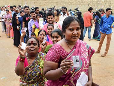 People queue up to cast their ballot during the polling day for the Karnataka Assembly election 2018 in Bengaluru. PTI