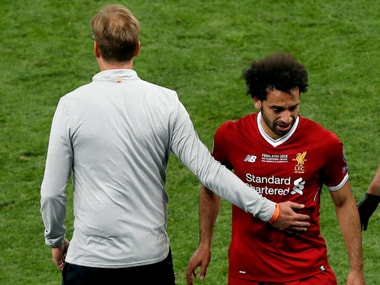 Liverpool manager Jurgen Klopp with Mohamed Salah who walks out of the field after suffering an injury. AP