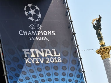 A placard bearing the logo of the UEFA Champions League Cup final is displayed at the fan zone in Kiev. AFP