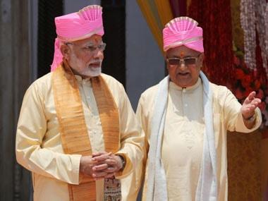 Nepalese Prime Minister Khadga Prasad Oli, right, and Prime Minister Narendra Modi visit the Janaki Temple, a revered Hindu temple in Janakpur, Nepal on Friday. PTI