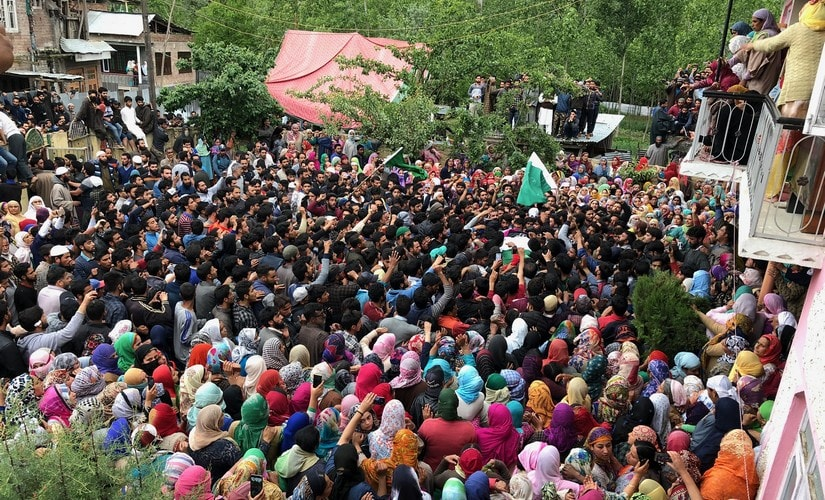 Villagers during the funeral procession of lecturer Mohammad Rafi Bhat who was killed along with five Hizb-ul-Mujahideen militants at an encounter in Shopian on Sunday. PTI
