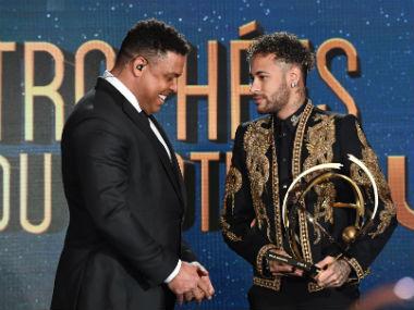 Neymar receives the Best Ligue 1 Player award from former Brazilian international player Ronaldo. AFP