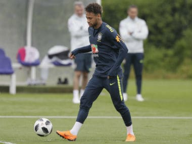 Brazil's Neymar controls the ball during  team training session in London. AP