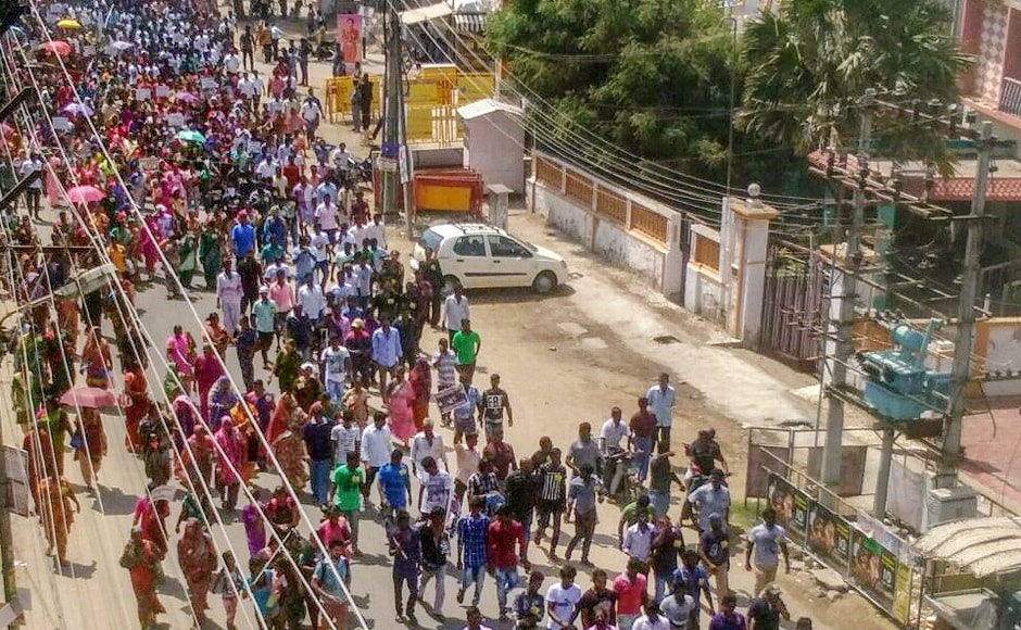 Thousands of agitators march through the streets. They insisted on taking out a rally to the district collectorate, after they were denied permission to march towards the copper smelter plant. PTI