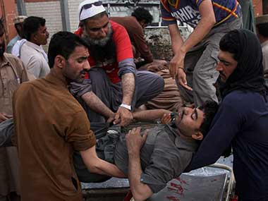 Pakistani volunteers and mine workers shift their injured colleague on a stretcher upon arrival at a hospital in Quetta, Pakistan. AP