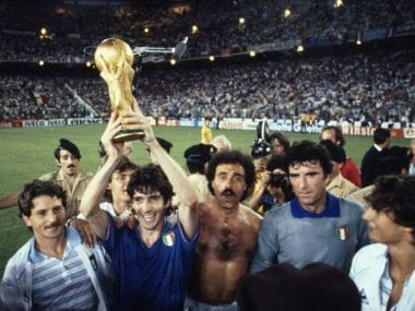 Italy's Paolo Rossi lifts aloft the FIFA World Cup Trophy in 1982. AFP