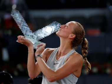 Petra Kvitova celebrates with the trophy after winning the Madrid Open title. Reuters