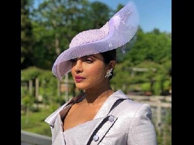 Prince Harry, Meghan Markle royal wedding: Priyanka Chopra stuns in chic Vivienne Westwood dress suit