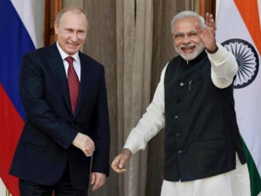 File image of Vladimir Putin and Narendra Modi. PTI