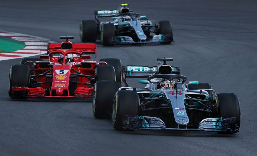Formula One F1 - Spanish Grand Prix - Circuit de Barcelona-Catalunya, Barcelona, Spain - May 13, 2018 Mercedes' Lewis Hamilton leads Ferrari's Sebastian Vettel and Mercedes' Valtteri Bottas behind the safety car (not pictured) during the second lap of the race REUTERS/Albert Gea - RC144CFE1CC0