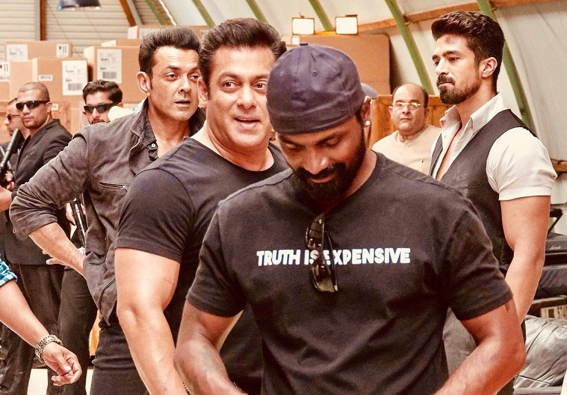Remo D'Souza (centre) with Salman Khan and Bobby Deol in the background on the set of Race 3. Image via Twitter