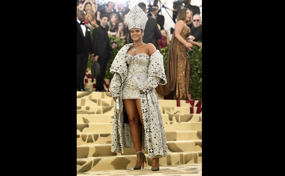 Rihanna looked absolutely papal when she arrived in a Maison Margiela pearl- and crystal-embellished gown by John Galliano, complete with a matching papal mitre and necklace. Photo by Evan Agostini/Invision/AP