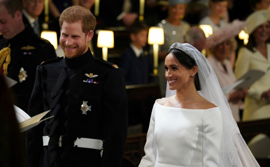 The new Duke and Duchess of Sussex exchanged vows at the altar in St. George's Chapel in an emotional event. Reuters