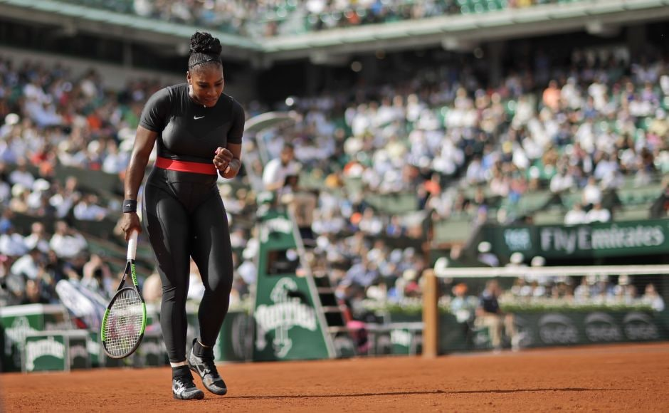 Serena Williams wore a black bodysuit with long leggings and a red waistband for her first round French Open match at Court Philippe Chatrier. She defeated Krystina Pliskova of the Czech Republic 7-6, 6-4. AP
