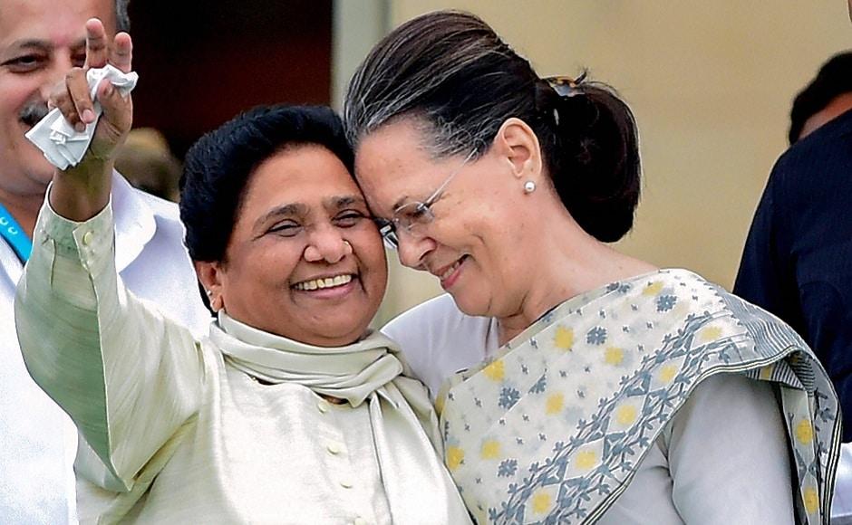 Congress' Sonia Gandhi with BSP chief Mayawati. PTI
