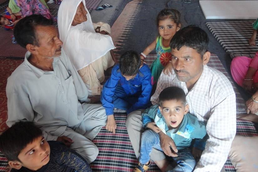 Surinder Kumar with his family at a makeshift camp in Samba. Image courtesy Jamsheed Malik