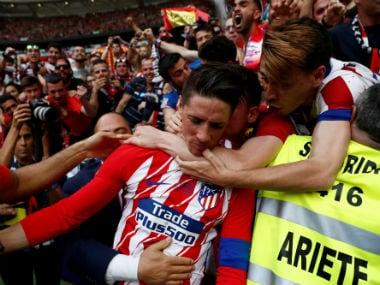 Atletico Madrid's Fernando Torres celebrates scoring his second goal. Reuters
