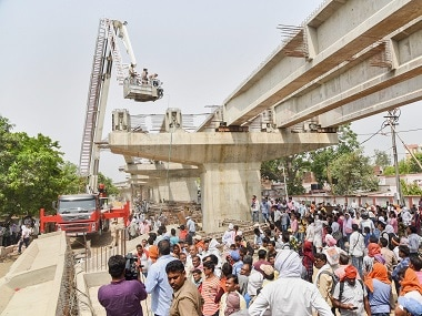 Rescue and relief work in progress at the flyover-collapse site in Varanasi. PTI