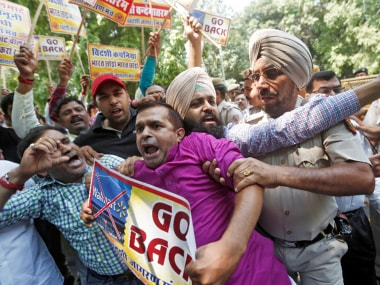 Activists from Swadeshi Jagran Manch, a wing of RSS, scuffle with police during a protest against Walmart in New Delhi. Reuters