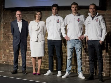 (L-R) Chief technical officer Paddy Lowe, deputy team principal Claire Williams, Canadian racing driver Lance Stroll, Russian racing driver Sergey Sirotkin and Polish racing driver Robert Kublitsa pose during the Williams Formula One 2018 season launch in London. AFP