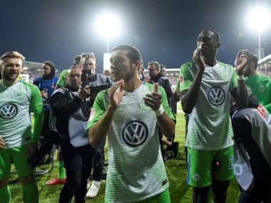 Wolfsburg's William and Josuha Guilavogui applaud fans after the match. Reuters