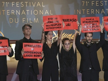 Cannes 2018: Cast, crew members of Brazilian film hold up placards to protest against 'genocide' of native people