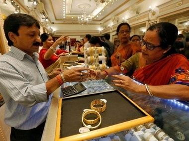 Gold prices decline by Rs 100 to Rs 32,750 per 10 gram on sluggish demand from jewellers; silver advances