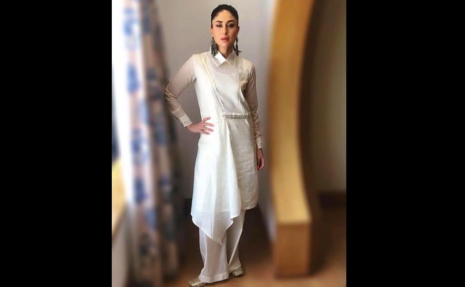 Kareena Kapoor opts for a plain white kurta paired with palazzos. Image from Instagram/@kareenakakapoor.arabic