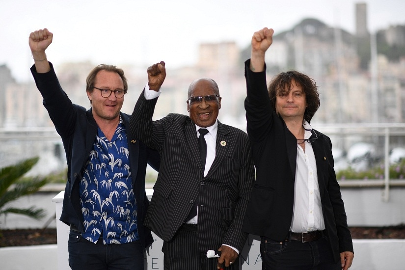 French director Nicolas Champeaux, South African anti-Apartheid campaigner and former political prisoner Andrew Mlangeni and French co-director and screenwriter Gilles at Cannes Film Festival 2018. AFP