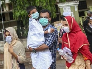 People wear safety masks as a precaution against the Nipah virus. File image. PTI