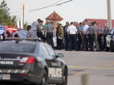 Police at the scene of the Oklahoma restaurant shooting. AP
