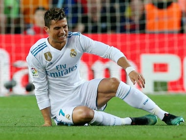 Real Madrid's Cristiano Ronaldo goes down after sustaining an injury against Barcelona. Reuters
