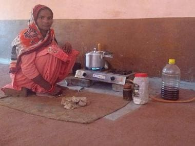 A woman using an LPG connection to cook food. Firstpost/Vivek Anand