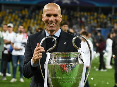 Zinedine Zidane with Real Madrid's third consecutive Champions League trophy. AFP