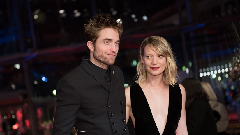 Robert Pattinson and Mia Wasikowska on the red carpet for the premiere of Damsel during the 68th Berlinale film festival on February 16, 2018 in Berlin. AFP/Stefanie Loos