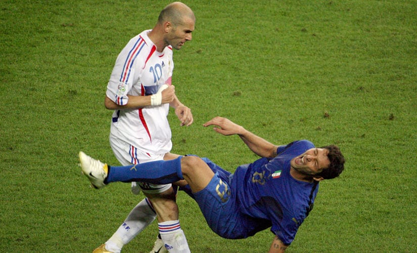 (FILES) In this file photo taken on July 09, 2006 shows French midfielder Zinedine Zidane (L) gesturing after head-butting Italian defender Marco Materazzi during the World Cup 2006 final football match between Italy and France at Berlin's Olympic Stadium. / AFP PHOTO / John MACDOUGALL