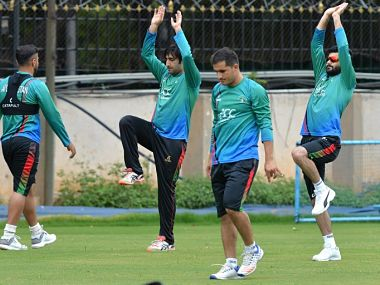 Afghanistan test cricket team along with their captain Asghar Stanikzai (2R) stretch before the team's practice session. AFP