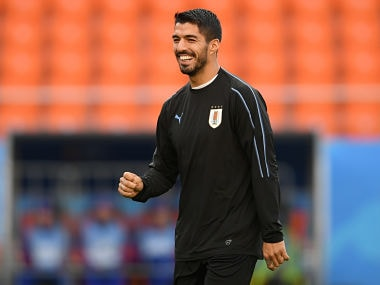 Uruguay's forward Luis Suarez smiles as he takes part in a training session at Ekaterinburg Stadium in Ekaterinburg on June 14, 2018, a day ahead the team's Russia 2018 World Cup Group A opening football match against Egypt. / AFP PHOTO / JORGE GUERRERO
