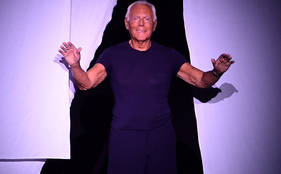 Giorgio Armani acknowledges the audience after the Armani men and women's spring/summer 2019 collection fashion show in Milan, on June 18, 2018. AFP/Miguel Medina