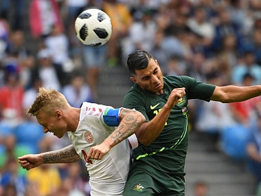 Denmark's defender Simon Kjaer (L) and Australia's forward Andrew Nabbout (R) go up for a header. AFP