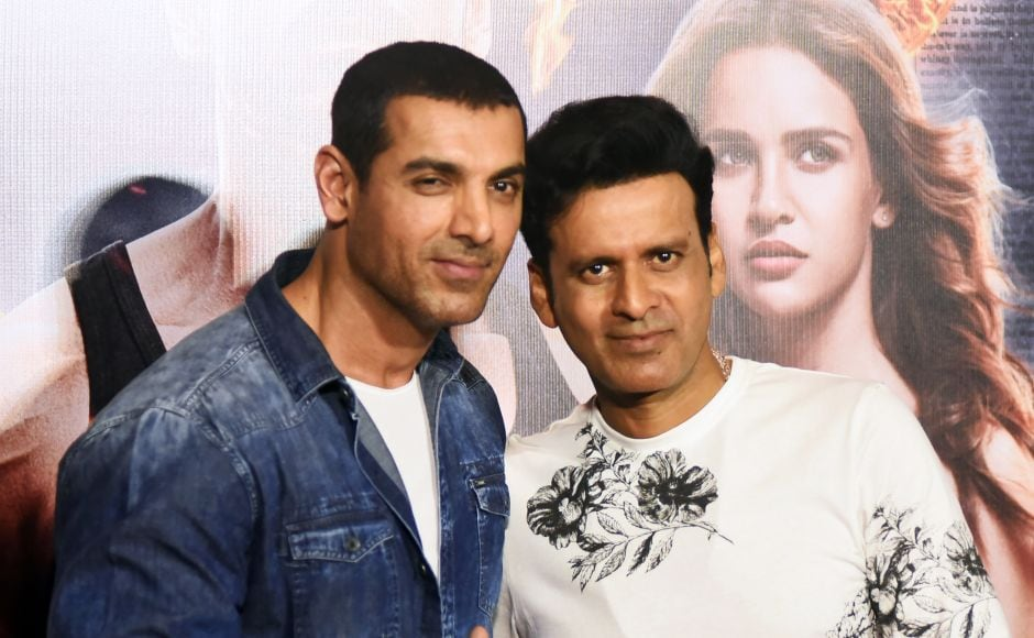 John Abraham (L) and Manoj Bajpayee attend the trailer launch of Satyameva Jayate. AFP
