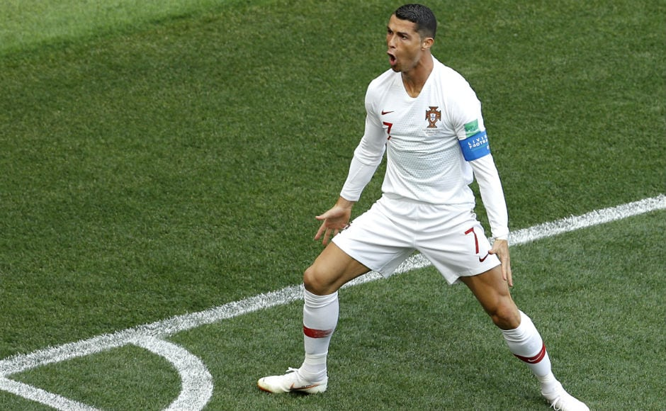 Cristiano Ronaldo celebrates after scoring against Morocco, collecting his fourth goal of the ongoing tournament. AP