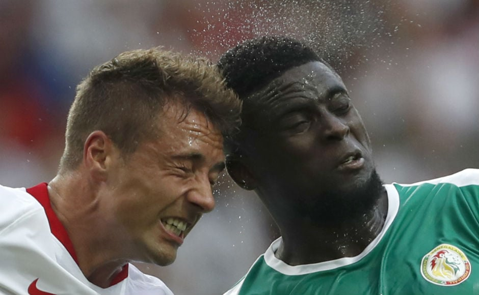 Poland's Thiago Cionek and Senegal's Alfred Ndiaye go for a header during their Group H encounter. AP